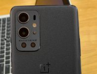 OnePlus 9 Pro Stellar (Sandstone) Black poses for the camera